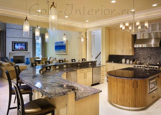 Двухуровневая барная стойка в интерьере кухни-гостиной